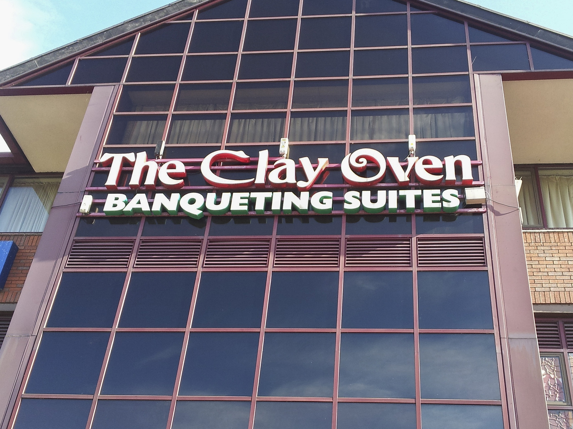 The Clay Oven Alperton - façade sign